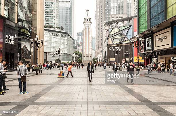 chongqing liberation monument pedestrian street - chongqing stock photos and pictures