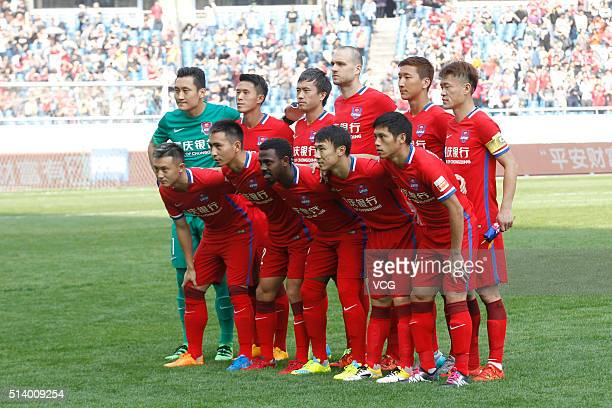 Chongqing Lifan players pose before the first round match of CSL Chinese Football Association Super League between Chongqing Lifan and Guangzhou...