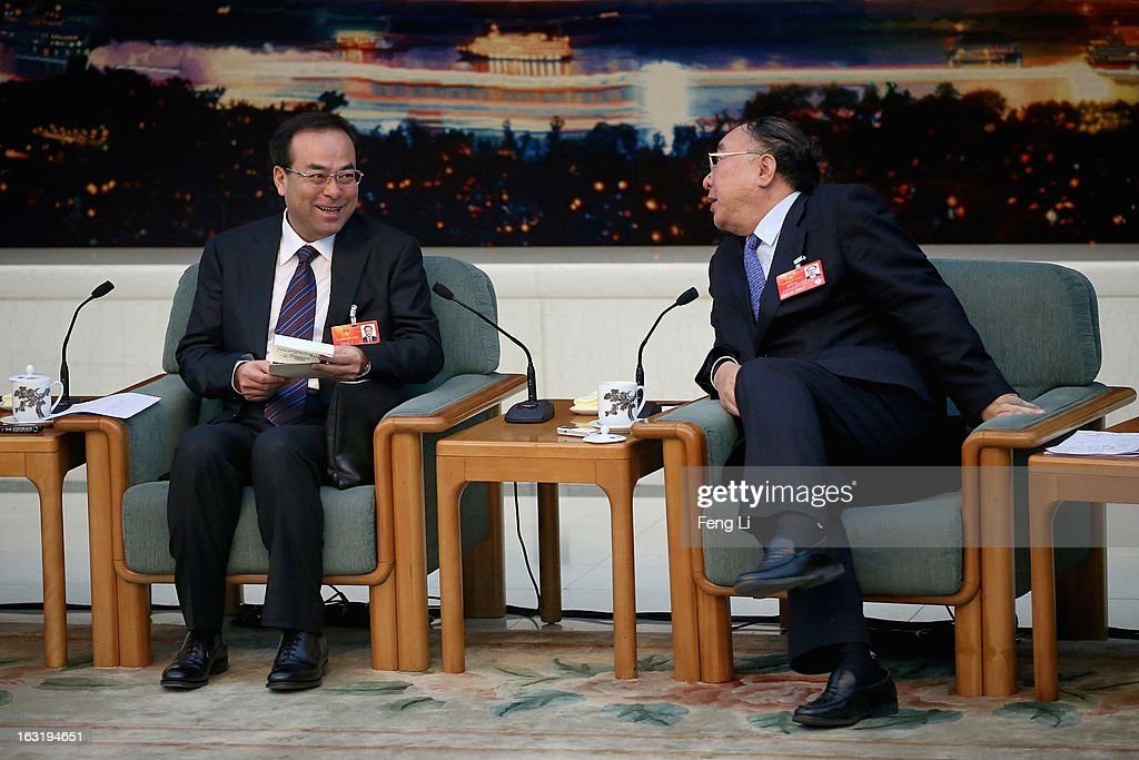 Chongqing Municipality Communist Party Secretary Sun Zhengcai (L) talks with Chongqing Mayor Huang Qifan (R) during the Chongqing delegation's group meeting during the annual National People's Congress at the Great Hall of the People on March 6, 2013 in Beijing, China. Sun answers media's question Wednesday that he knows nothing about the trial of Bo Xilai. The 12th National People's Congress goes on till March 17th.