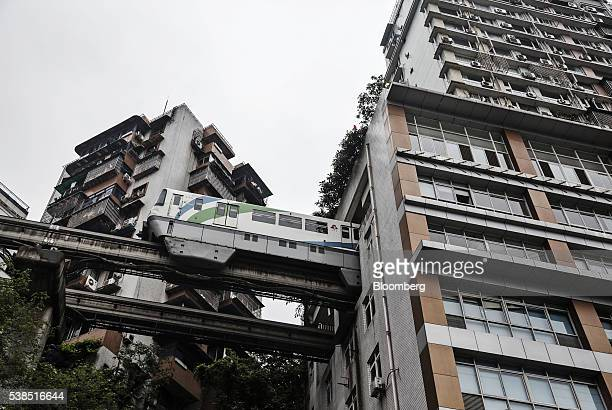 A Chongqing Rail Transit Group Co train leaves a station under a residential building in Chongqing China on Tuesday April 12 2016 The municipality of...