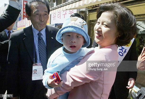 Choo MiAe leader of The Millennium Democratic Party holds a baby during a preelection campaign on April 14 2004 in Seoul South Korea The people of...