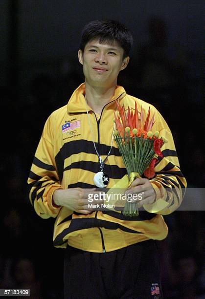 Choong Hann Wong of Malaysia poses for a picture during the medal ceremony for the men's singles badminton match on day eleven of the Melbourne 2006...