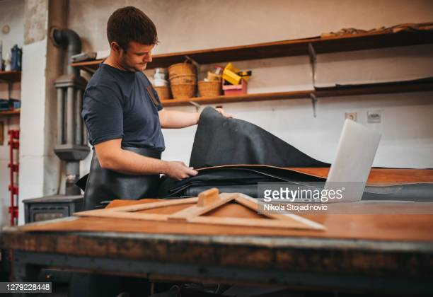 chooses leather for sewing - leather belt stock pictures, royalty-free photos & images