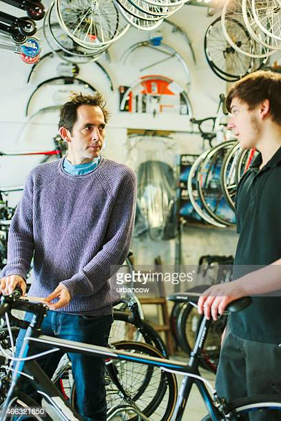 Choosing a bike, bicycle shop, talking to sales assistant