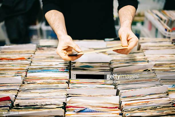 Choosing a second hand vinyl record in a record store