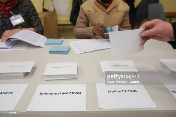 Choosing ballots of the candidates in the first round of the Presidential race in the Belleville neighbourhood in the 19th arrondissement on April 23...