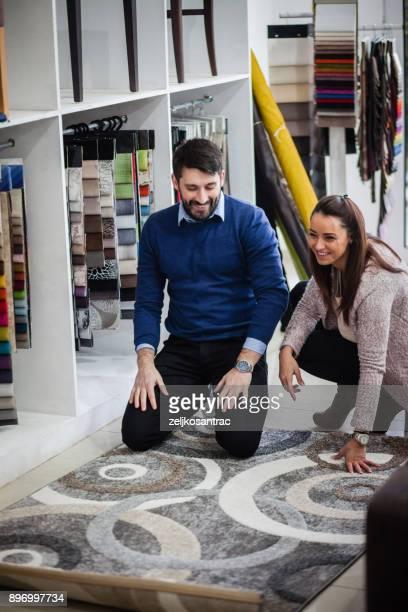 choosing carpet in housewares hypermarket