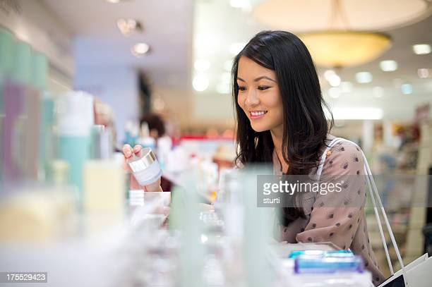 choosing cosmetics - cosmetics stock pictures, royalty-free photos & images