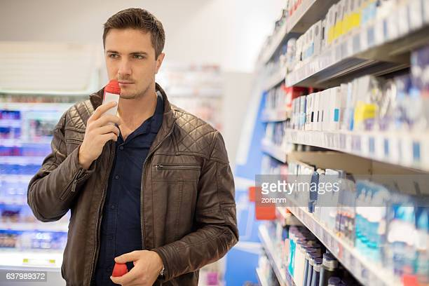 Choosing deodorant in local supermarket