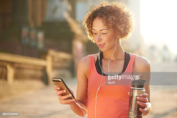choosing exercise music - liverpool training stock pictures, royalty-free photos & images