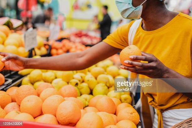 choosing groceries at the market during a pandemic - cat face mask stock pictures, royalty-free photos & images