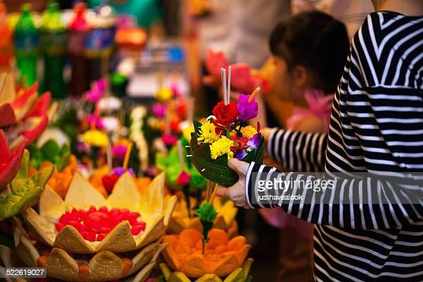 choosing krathong - loi krathong stock photos and pictures