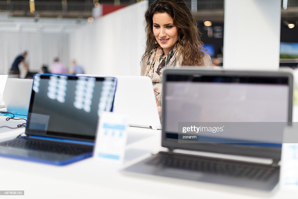 Choosing laptop : Stock Photo