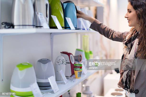 choosing new kettle - consumentisme stockfoto's en -beelden