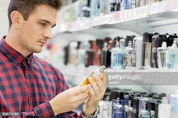 Choosing perfume in department store