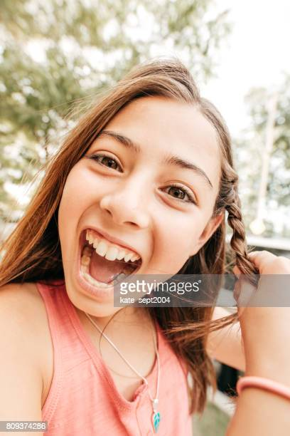 choosing right braces for your teen - beautiful girl smile braces vertical stock photos and pictures