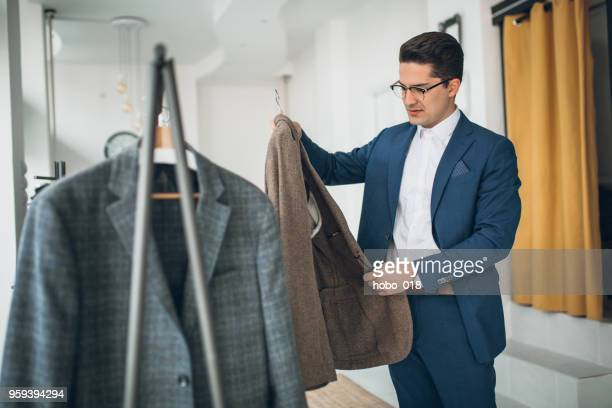 choosing suit - men fashion stock pictures, royalty-free photos & images