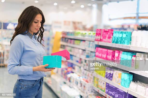choosing tampons - menstruation stock pictures, royalty-free photos & images