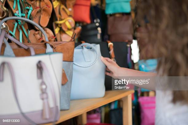 choosing the perfect handbag - leather purse stock pictures, royalty-free photos & images