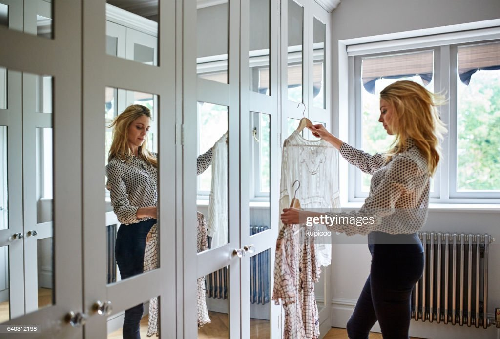 Choosing the perfect outfit : Stock Photo