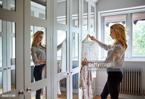 choosing the perfect outfit - blouse stockfoto's en -beelden