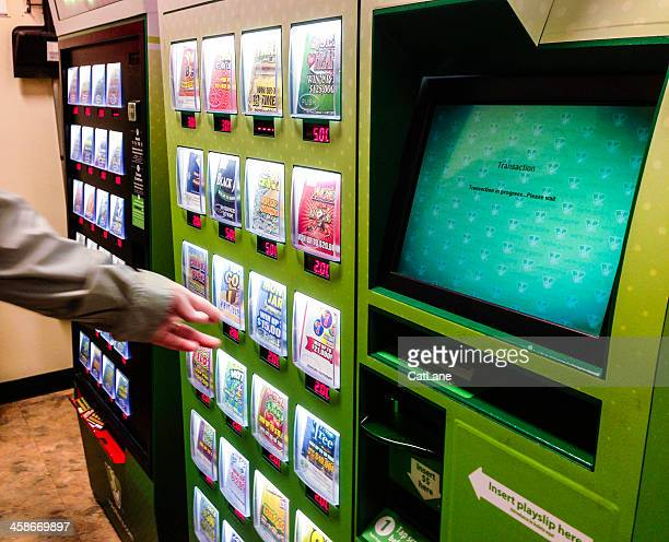 choosing tickets from a lottery vending machine - lottery ticket stock pictures, royalty-free photos & images