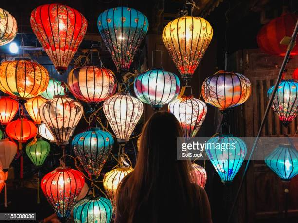 choosing vibrant homemade lanterns - chinese lantern festival stock pictures, royalty-free photos & images