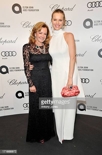 Chopard Co-President and Artistic Director Caroline Scheufele (L) and Eva Herzigova attend the 15th Annual White Tie and Tiara Ball to Benefit Elton John AIDS Foundation in Association with Chopard at Woodside on June 27, 2013 in Windsor, England. No sales to online/digital media worldwide until the 14th of July. No sales before July 14th, 2013 in UK, Spain, Switzerland, Mexico, Dubai, Russia, Serbia, Bulgaria, Turkey, Argentina, Chile, Peru, Ecuador, Colombia, Venezuela, Puerto Rico, Dominican Republic, Greece, Canada, Thailand, Indonesia, Morocco, Malaysia, India, Pakistan, Nigeria. All pictures are for editorial use only and mention of 'Chopard' and 'The Elton John Aids Foundation' are compulsory. No sales ever to Ok, Now, Closer, Reveal, Heat, Look or Grazia magazines in the United Kingdom. No sales ever to any jewellers or watchmakers other than Chopard