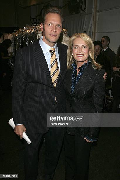 Chopard President Marc Hruschka and designer Pam Devos pose backstage at the Pamella Roland Fall 2006 fashion show at Bryant Park during Olympus...