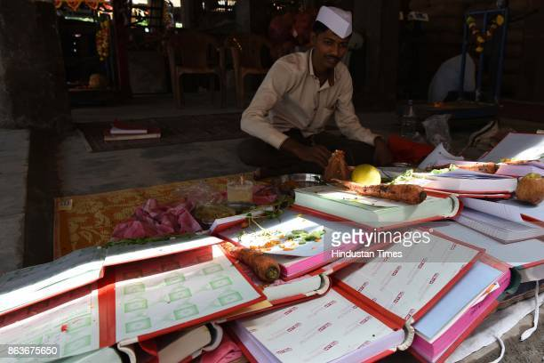 Chopda Pujan is performed at APMC Market on October 19 2017 in Mumbai India On this day they do puja of account books and start writing their new...