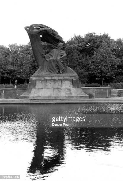 Chopin statue graces a pool in Warsaw's Lazienki Park Credit The Denver Post