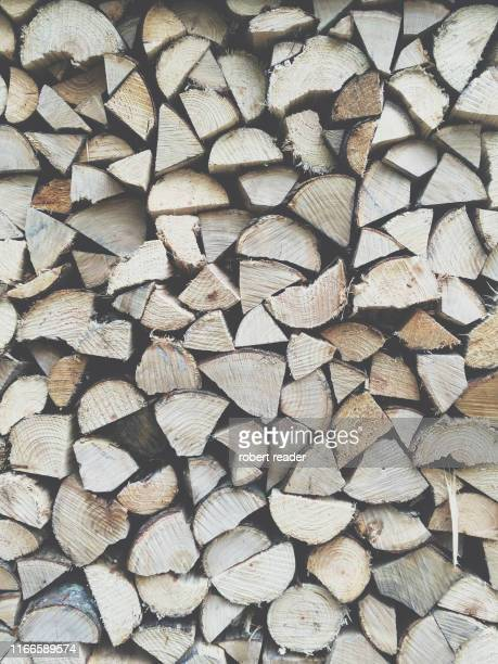 chopped fire wood in wood store - firewood stock pictures, royalty-free photos & images