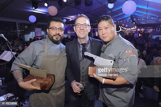 Chopped host Ted Allen poses with Judge's Choice Winner Chef Mario Hernandez and People's Choice Winner Chef Stephen Yen of The Ainsworth at Rooftop...