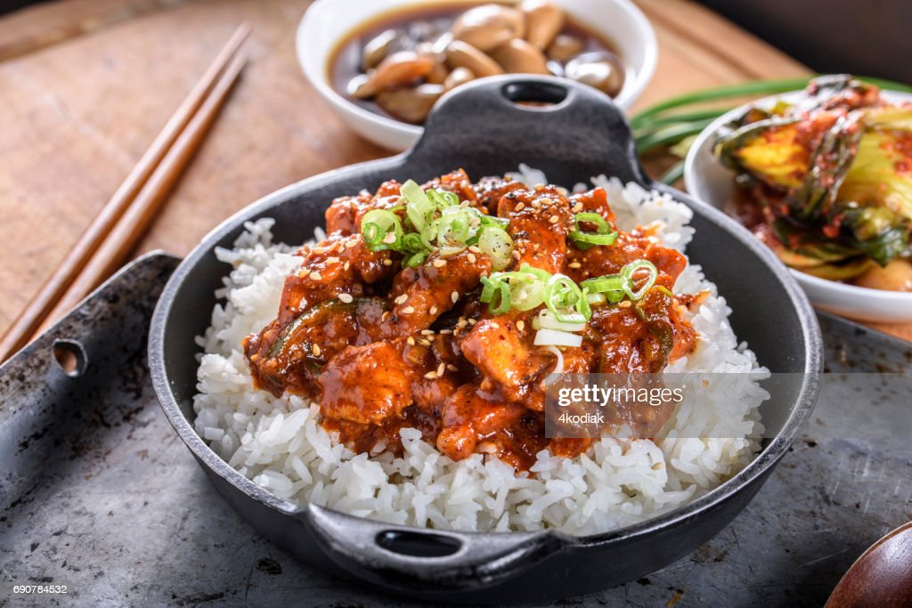 Chopped Pork Meat Cooked with Red Chili Paste, Gochujang Sauce, over Rice : Stock Photo