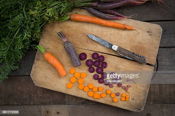Chopped Purple Haze and yellow carrot on wooden board