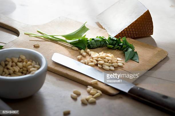 Chopped ramson, pine nuts and Pecorino cheese on chopping board
