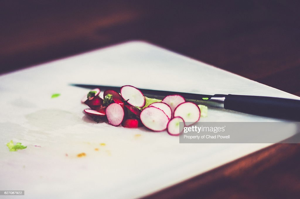Chopped Up Radish On A Cutting Board With Knife : Stock Photo