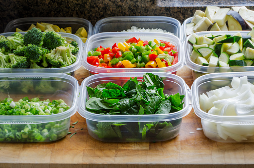 chopped vegetables in plastic containers 465083128