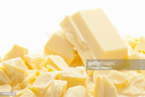 chopped white chocolate - white chocolate stock photos and pictures