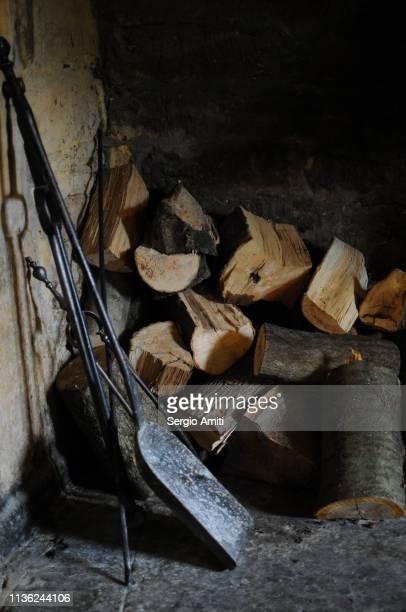 Chopped wood and fireplace shovel and poker