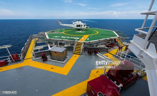 A chopper landed on the helideck of La Muralla IV exploration oil rig operated by Mexican company Grupo R and working for Mexico's stateowned oil...