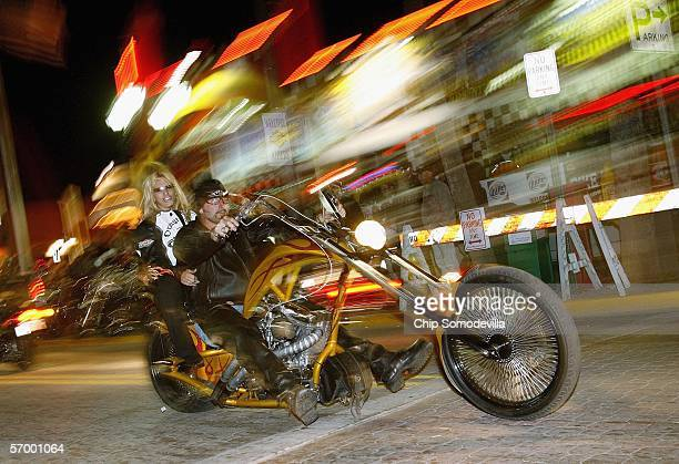 A chopper motorcycle cruises down Main Street during the first weekend of Bike Week March 4 2006 in Daytona Beach FL More than 500000 people are...