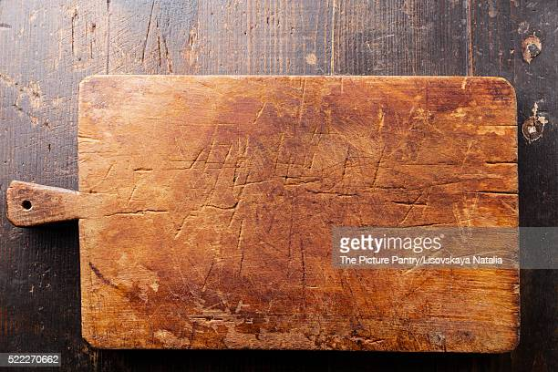 Chopping cutting board on wooden texture background