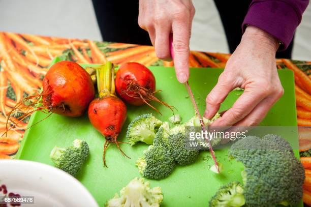 Chopping fresh vegetables.