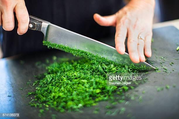 chopping parsley - küchenmesser stock-fotos und bilder
