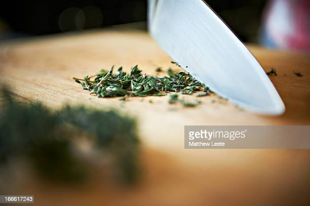 chopping tyhme - kitchen knife stock pictures, royalty-free photos & images