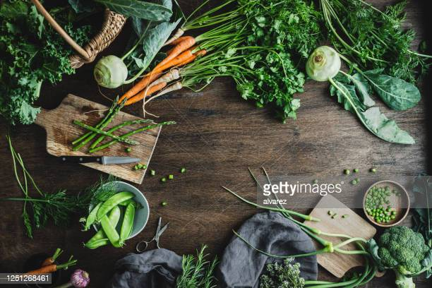 chopping vegetables for making salad - ingredient stock pictures, royalty-free photos & images