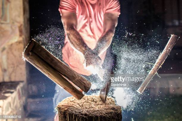 chopping wood with an explosion of dust. - chopping stock pictures, royalty-free photos & images