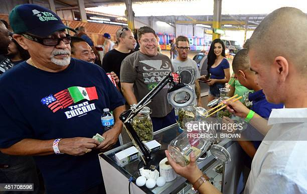 Chopsticks are used to carry the buds as cardcarrying medical marijuana patients watch a weighing at Los Angeles' firstever cannabis farmer's market...