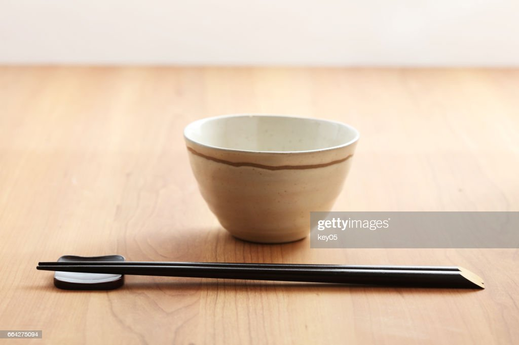 Chopsticks on a white bowl : Stock Photo